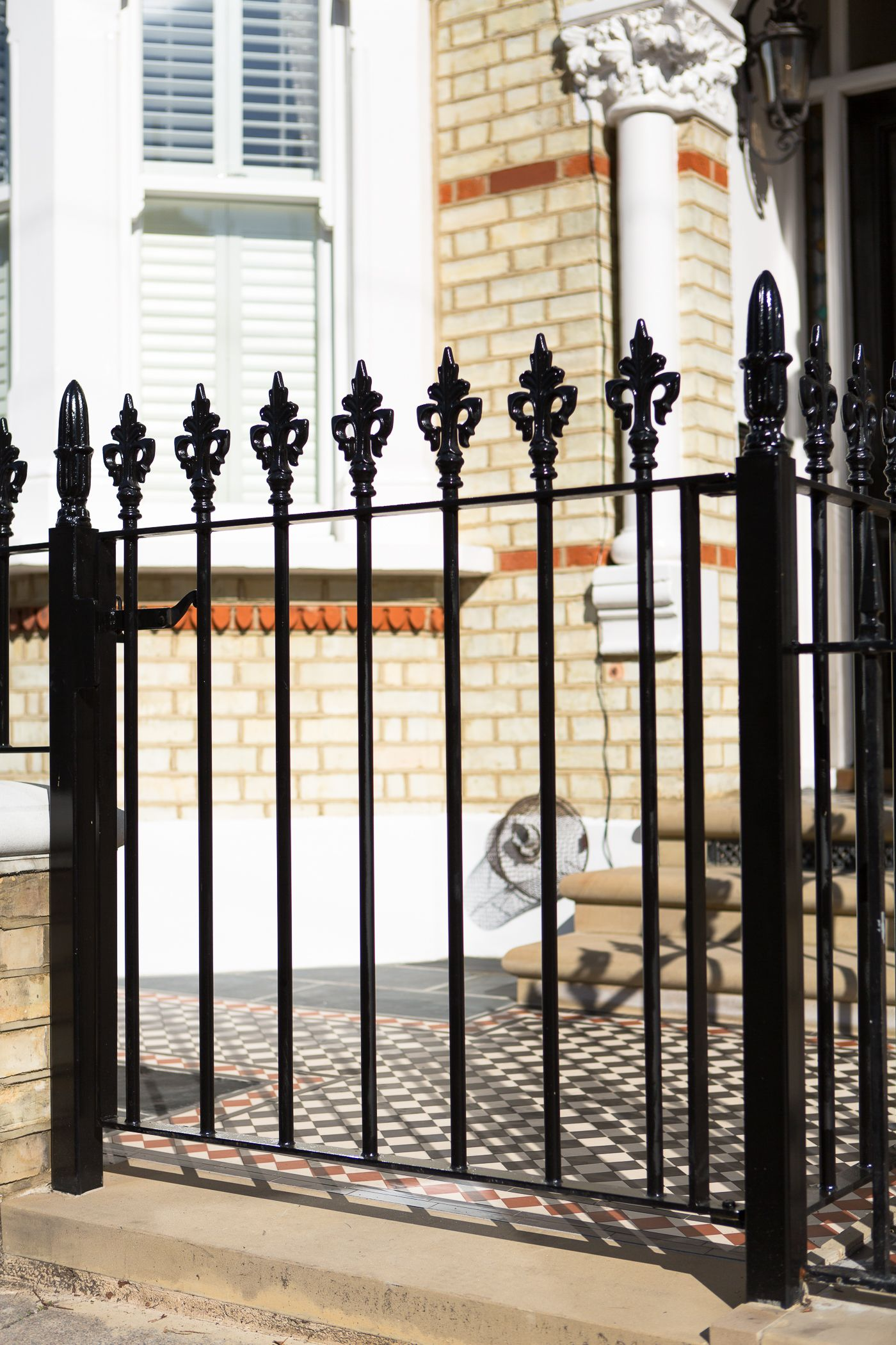 Black Cast Iron Gate With Trident Style Railing Heads Front