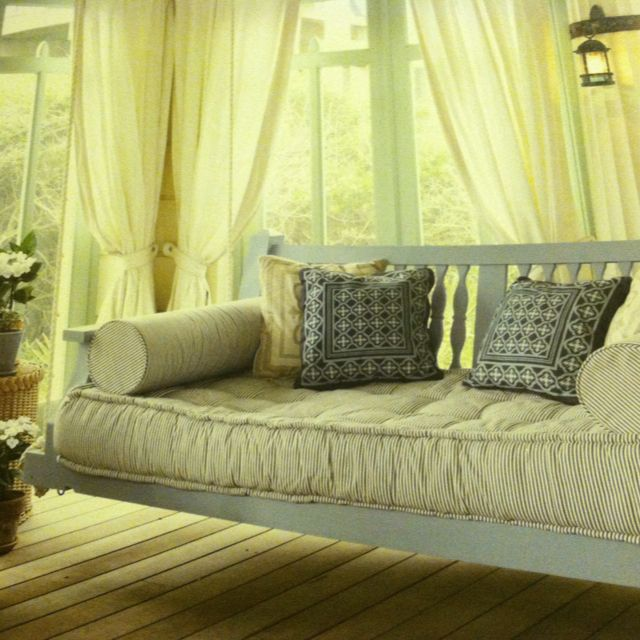 Outdoors porch swing turned into cozy couch.   Porch swing ...