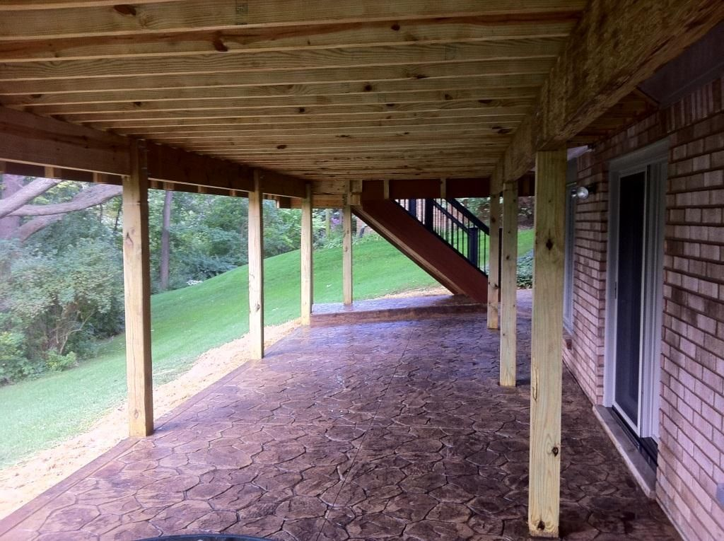 wood deck with underneath walkout | Rochester MI Stamped concrete ...