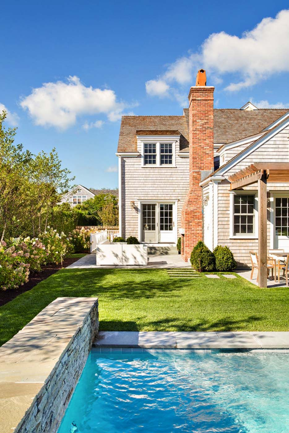 Shingle style house with beach chic interiors