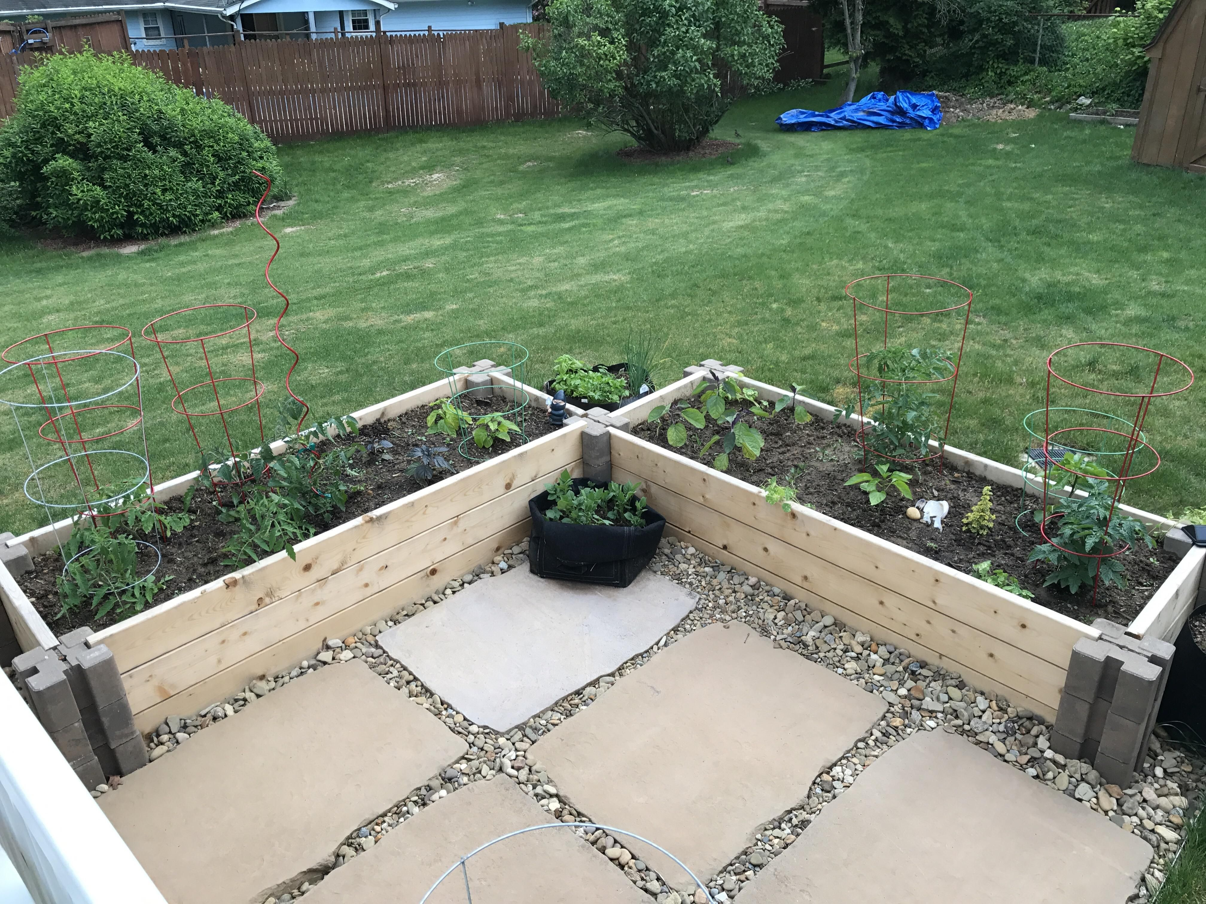New raised beds using Home Depot planter wall blocks.