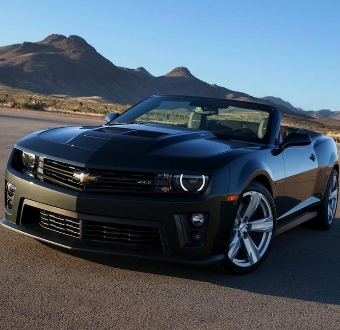 Black Camaro Hits The Open Road Under The Hot Desert Sun