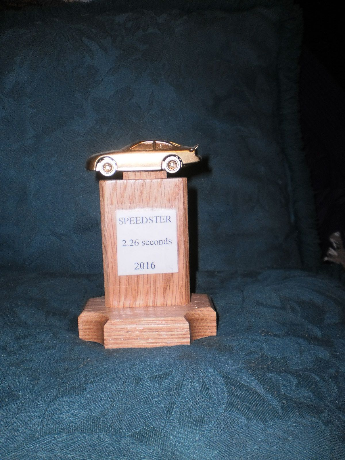 Pinewood Derby trophy made by our Webeloes leader.