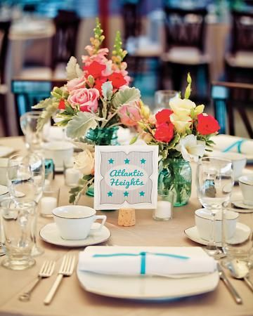 Make it your own wedding by adding unique, one of a kind details.  Here, many tiny teil blue mason jars were collected for table centerpieces.