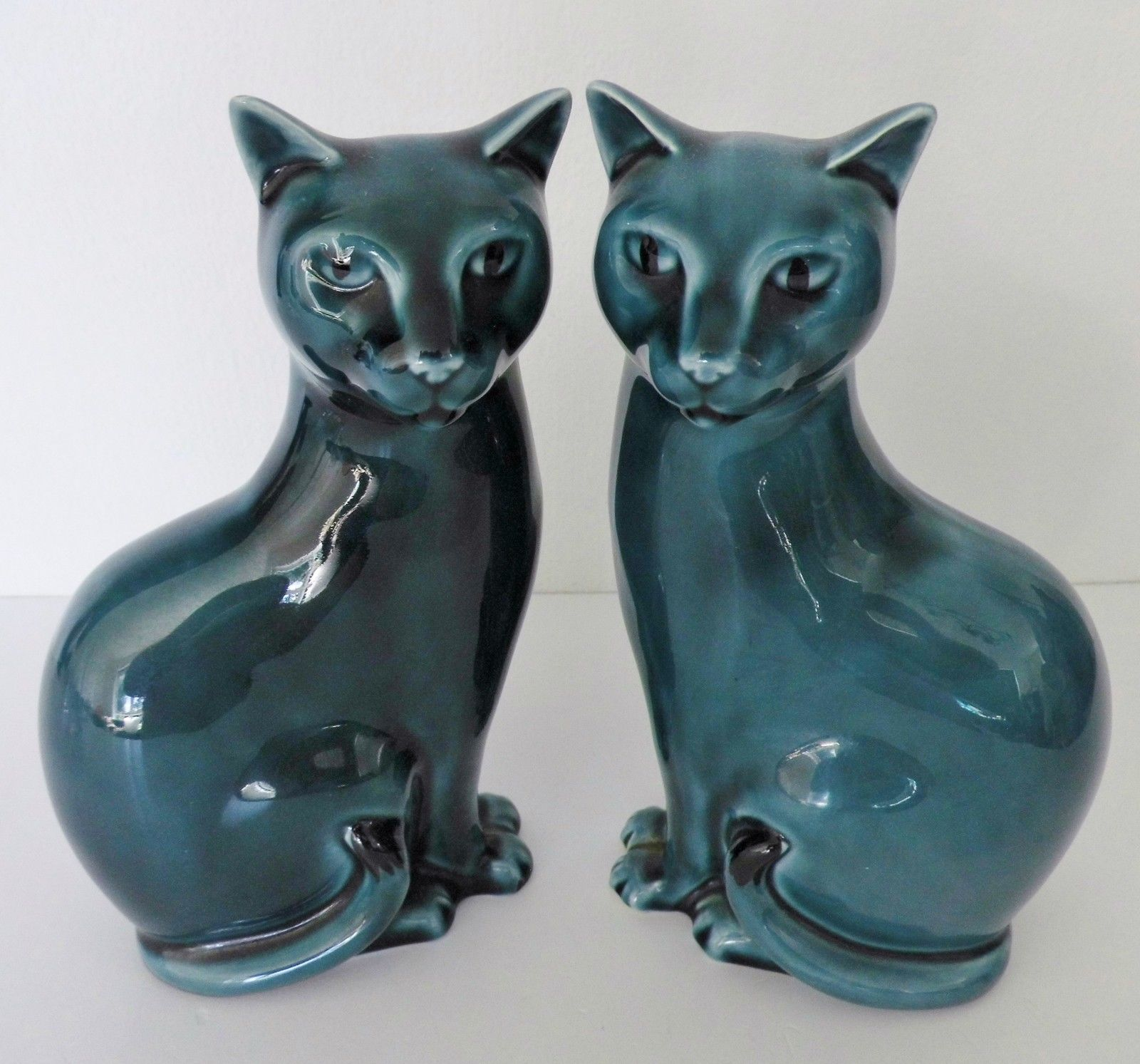 2 x POOLE POTTERY CATS LEFT AND RIGHT  About 16cm high