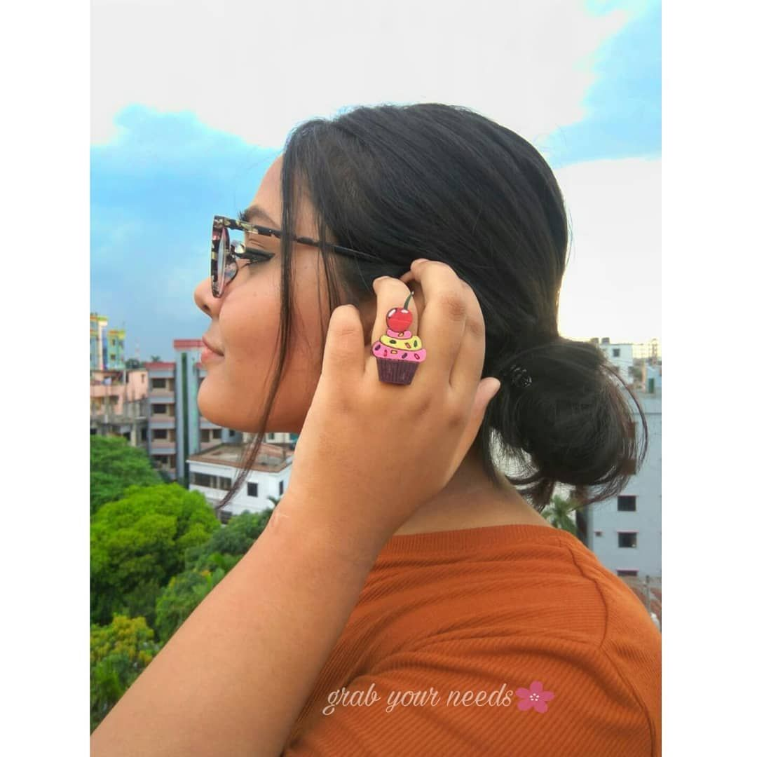 Please Dont copy this. For Cupcake lovers ❤ Color can be customized ❤  Cupcake Ring Price - 100 tk  Model - @rips____  Dont use any picture without permission  All rights reserved for Grab Your needs  Unauthorized reproduction is strictly prohibited.