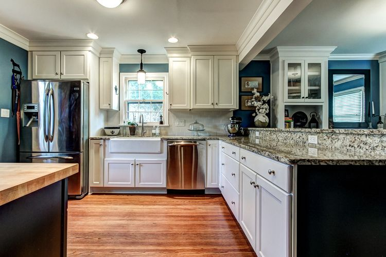Blue and white kitchen renovation with black stained