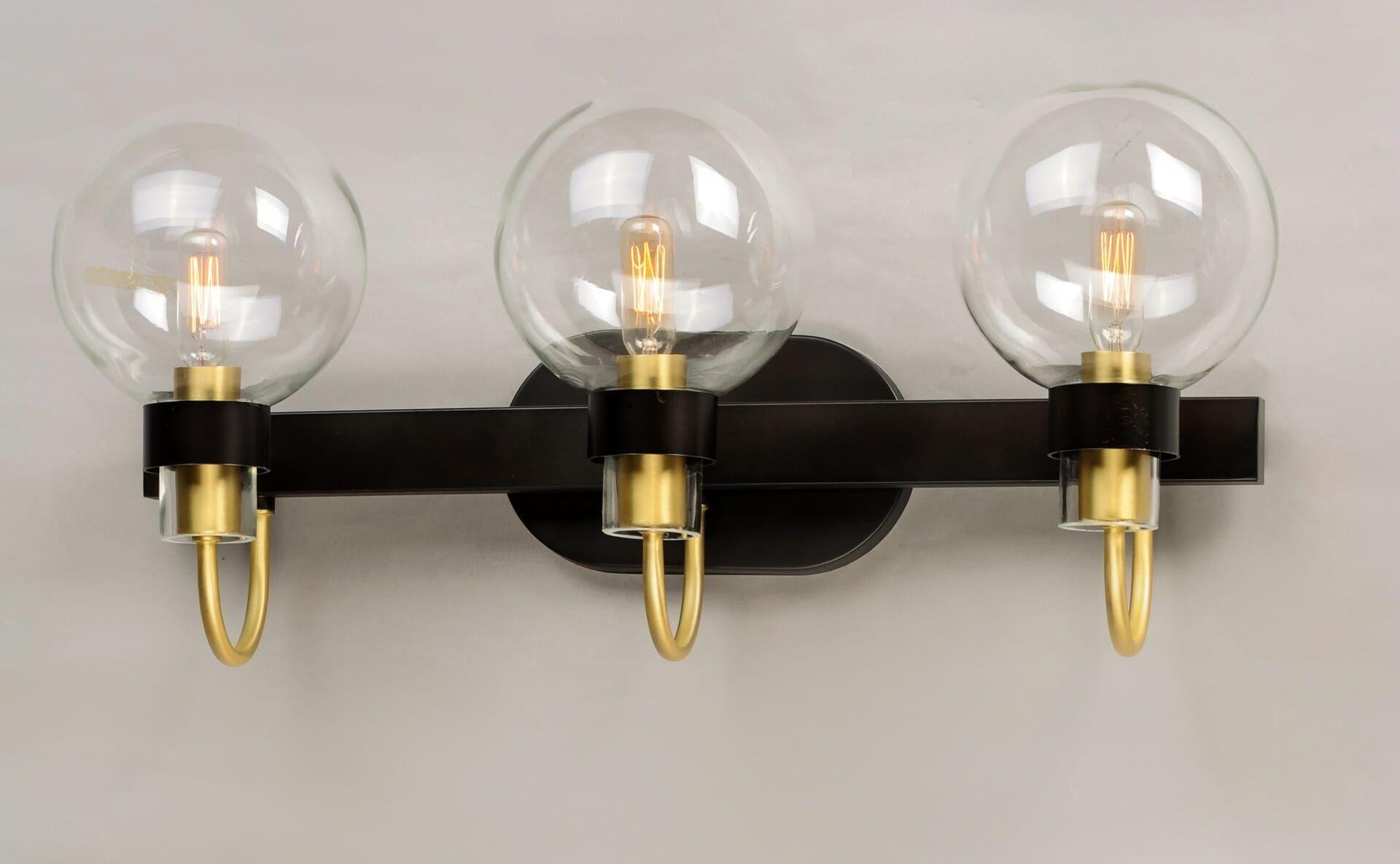Photo of Maxim Bauhaus 3-light bathroom wash basin lamp in bronze and satin brass