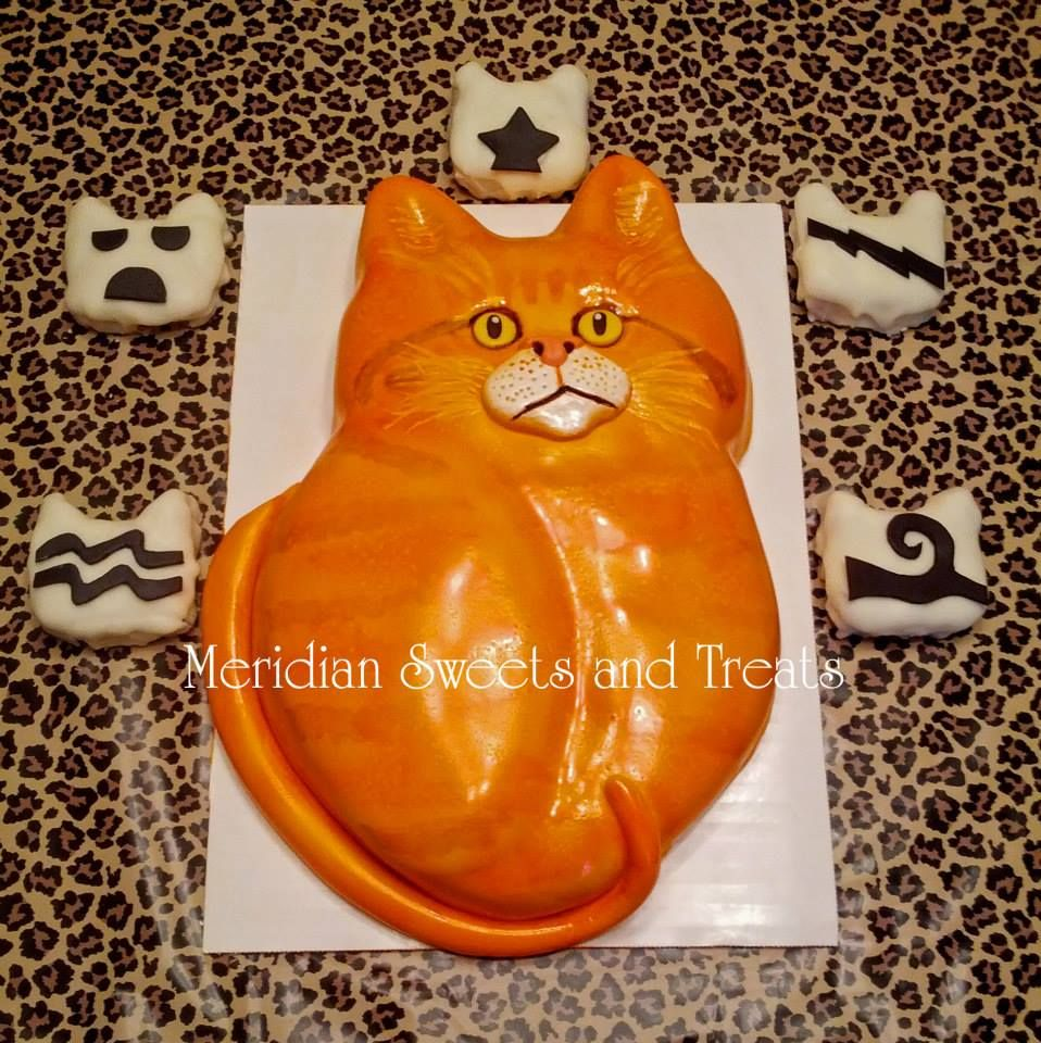 Warrior Cat cake and Warrior Clan cake balls Made by Meridian