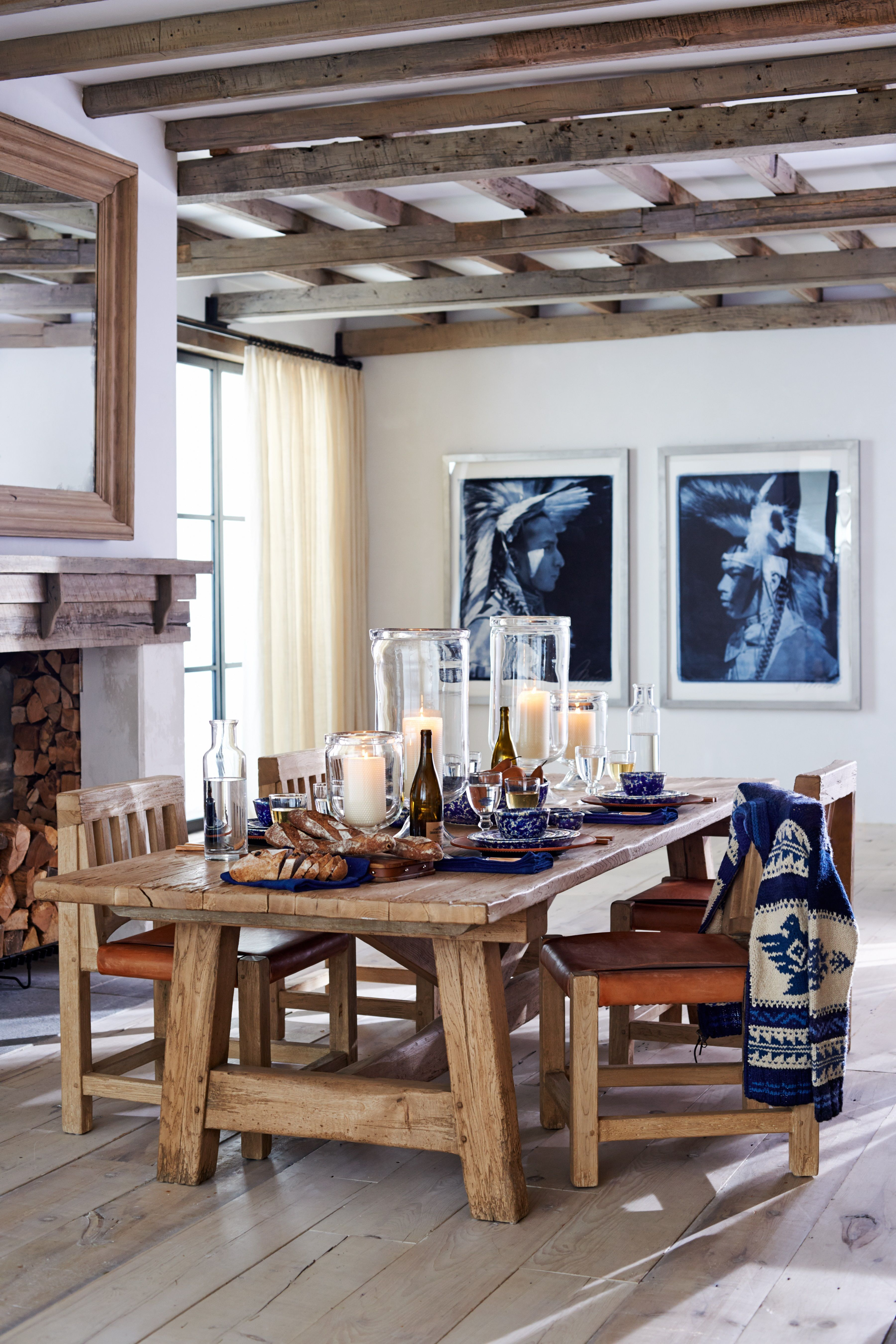 Ralph Lauren Home's rustic dining table in barn door oak sets a warm, inviting tone for gatherings.