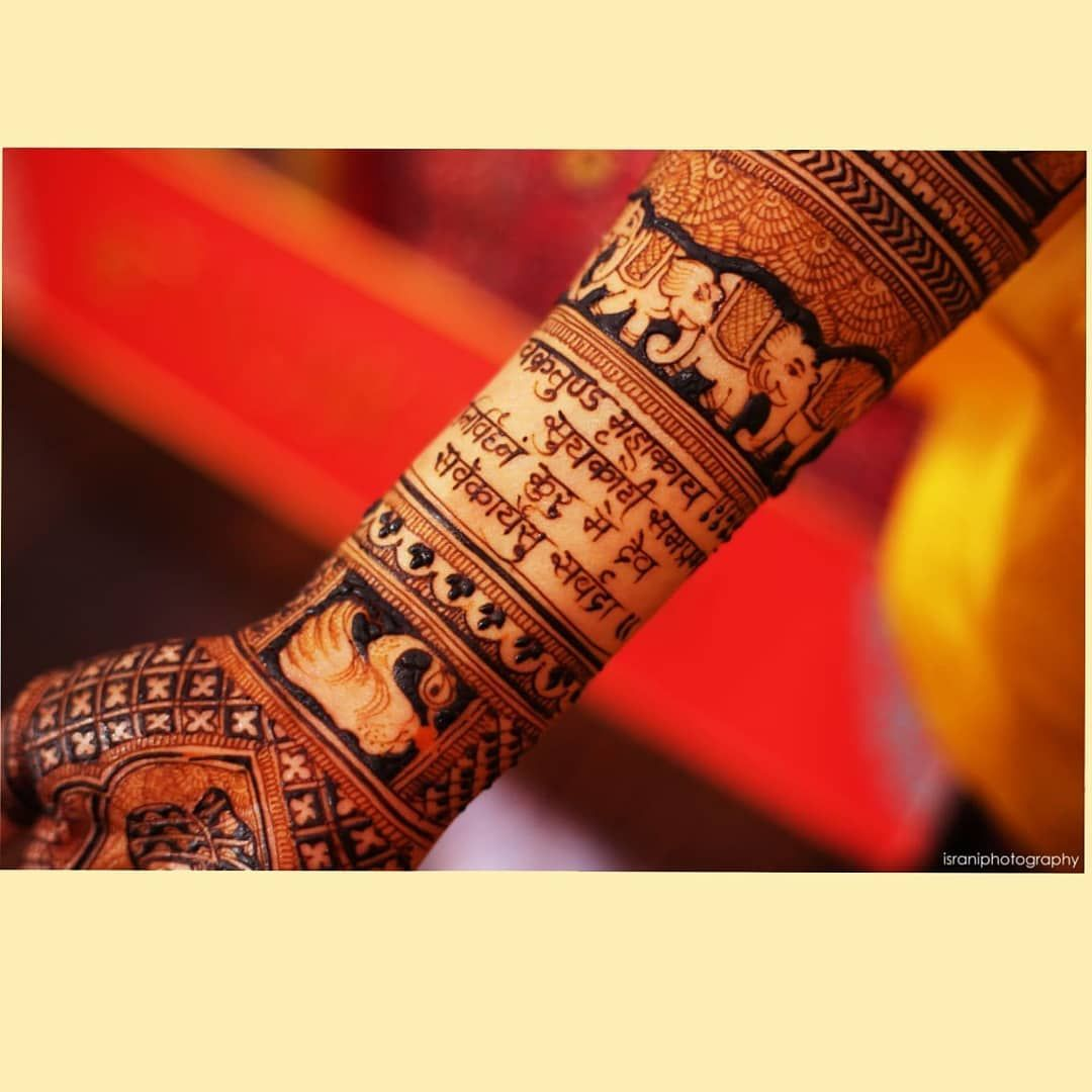 Eye catching mehendi design with a mantra written is new trend !  By @isrraniphotography . . . #indianwedding #jewelery #weddingbells #weddingfun #weddingdiaries #bridalinspiration #makeupartist #indianbride #bridalmakeup #bride #weddingseason #weddingphotography #weddinginspiration #weddingdress #weddingoutfit #bridesmaid #weddinglehenga #weddingjewellery #designerlehenga #bridaljewellery #wedding #weddingday #photography #mehendi  #makeup #prewedding #fashion #bridal #shaadidukaan