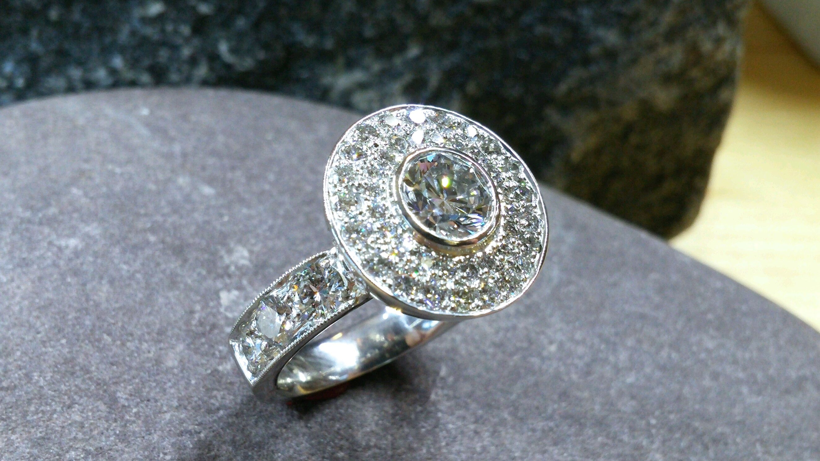 Double halo around this beautiful diamond!  This is a hand fabricated ring made by Stonehaven Jewelry.