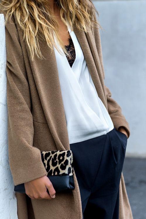 long tan sweater coat white silk wrap blouse, black pants, leopard purse