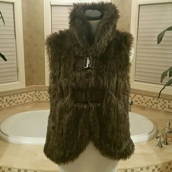 Faux fur vest Gorgeous chocolate brown faux fur vest with unique metal clasp satin lined I've never worn this it was too small for me Jackets & Coats Vests