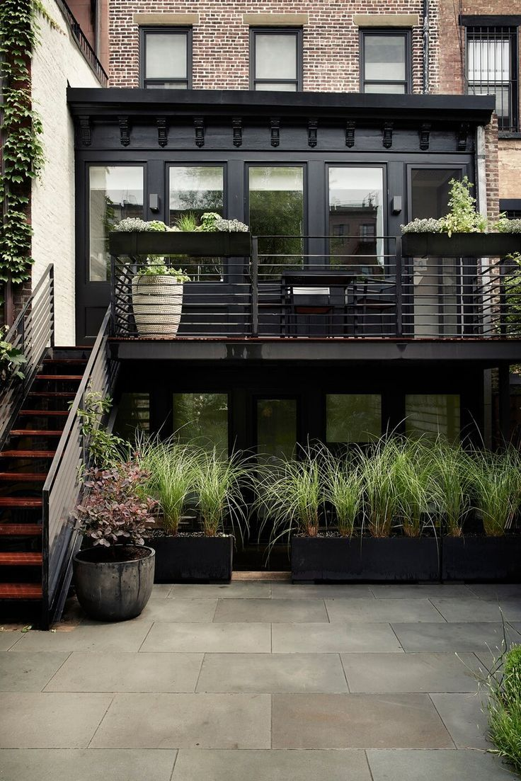 exterior this home has amazing exposed brick and iron railings