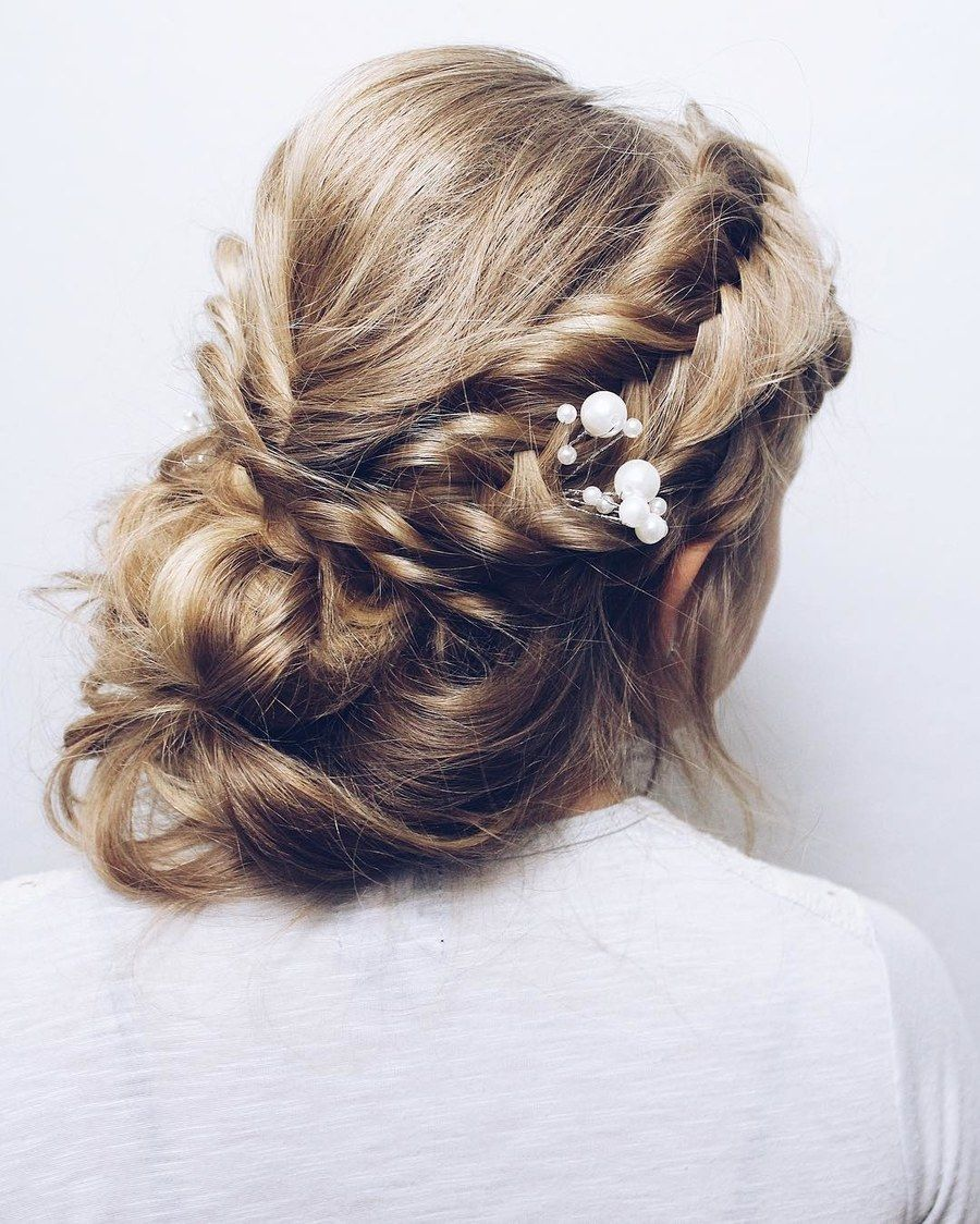Twists are anything but basic in this gorg updo add a pearl accent