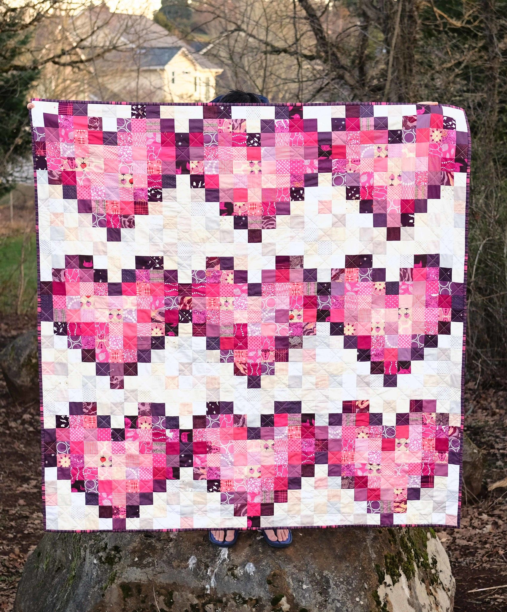 Pixel Love Scrap Quilt is part of Scrap quilts, Pixel quilting, Cowboy quilt, Quilts, Heart quilt, Quilt blocks - I talked a little in my last post about my scrap goals for the year one scrap quilt each month until my scrap bin is (more or less) bare  In February, I started this quilt with ambitions to finish before Valentine's Day and I finally finished the sewing down the binding last week  Scrap quilt number one took a long time, but it's done! I did have to cut a little bit from my stash because I have almost no purple scraps, but all of the neutrals and almost all of the pinks came right from the good old scrap bin  There is a tutorial available for this quilt and I followed the tutorial except I left the borders off of my quilt; I only had one good backing option in my stash and I wouldn't have had quite enough if I had added the borders  For the quilting, I did a simple crosshatch  When the squares on the quilt are this small, I usually just eyeball where the lines should be and don't bother marking them  They end up a little wibbly wobbly, but nothing too noticeable  The binding is an Anna Maria Horner voile  I think this is the first time I have done a voile binding and it was a dream to work with  The backing fabric is from Denyse Schmidt's Flea Market Fancy reprint  Even though I didn't finish the quilt in time for Valentine's Day, it is ready to go for next year! Do you want to join along in making some scrap quilts this year  I am working on a post with ideas for different scrap projects and hopefully that will be ready later this week  Pattern Pixel Love Tutorial Fabrics Various scraps from my overflowing scrap bin Backing Pink Seeds from Flea Market Fancy by Denyse Schmidt Binding Innocent Crush voile by Anna Maria Horner Batting Simply Natural Happy Cloud Batting