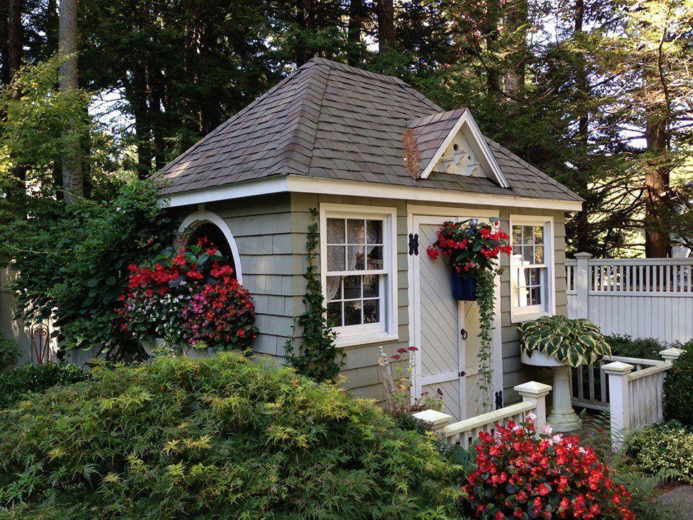 Little house enhance gardens charm award winning for Backyard cottage shed