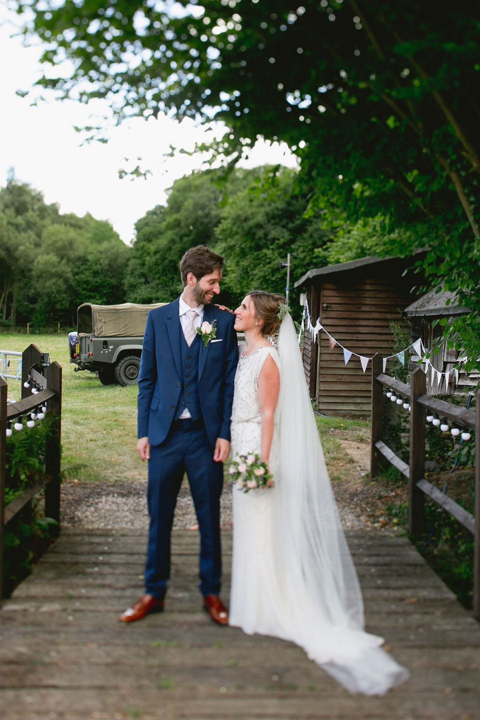 A jenny packham gown and gypsophila in her hair for a relaxed and