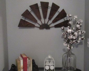 This is a 36 inch half windmill. Custom built with solid raw steel. Rusted lightly for the rustic look so sought after. Great farmhouse fixer upper style! Have 2 listings with extra quantities for this size, so they are always available for you. Still same production time as listed below. Thanks!  A vintage inspired rusty half windmill for your home. Ready to be hung on the wall & comes with a slotted hanger (for ease of hanging & added safety) hidden behind blade. We also spray a lig...