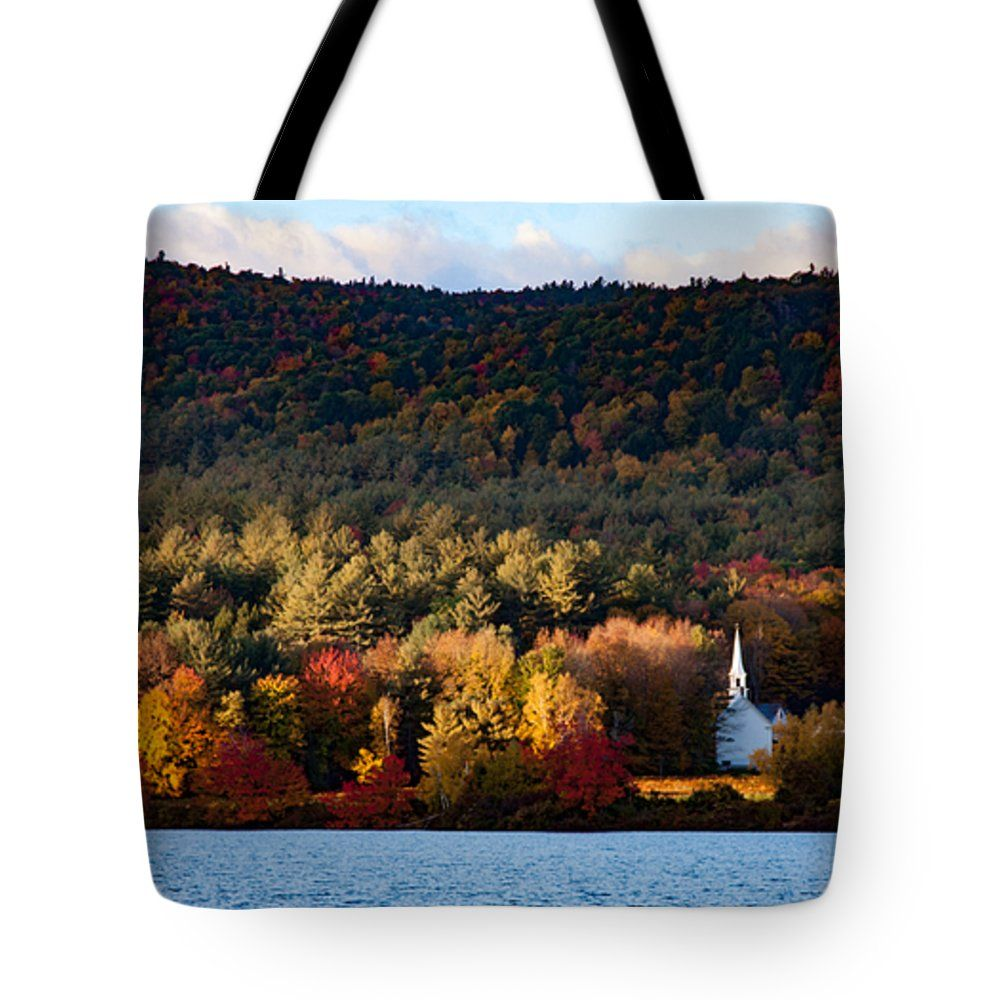 """sunshine through the window in the clouds Tote Bag 18"""" x 18"""" by Jeff Folger  The sun rose over the hills behind me and illuminated the little white church. The clouds were low so the sun climbed higher and then started to fall behing the clouds. this limited the light that fell on the hills above the little white church in Eaton New Hampshire."""