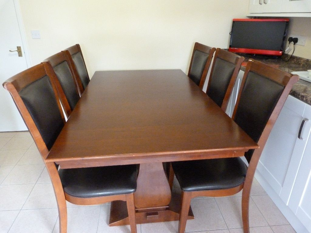 Real Wood Dark Brown Dining Sets With Six Luxurious Chairs
