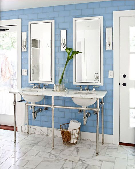 Cornflower Blue Subway Tile Covers The Entire Wall Of This Bathroom