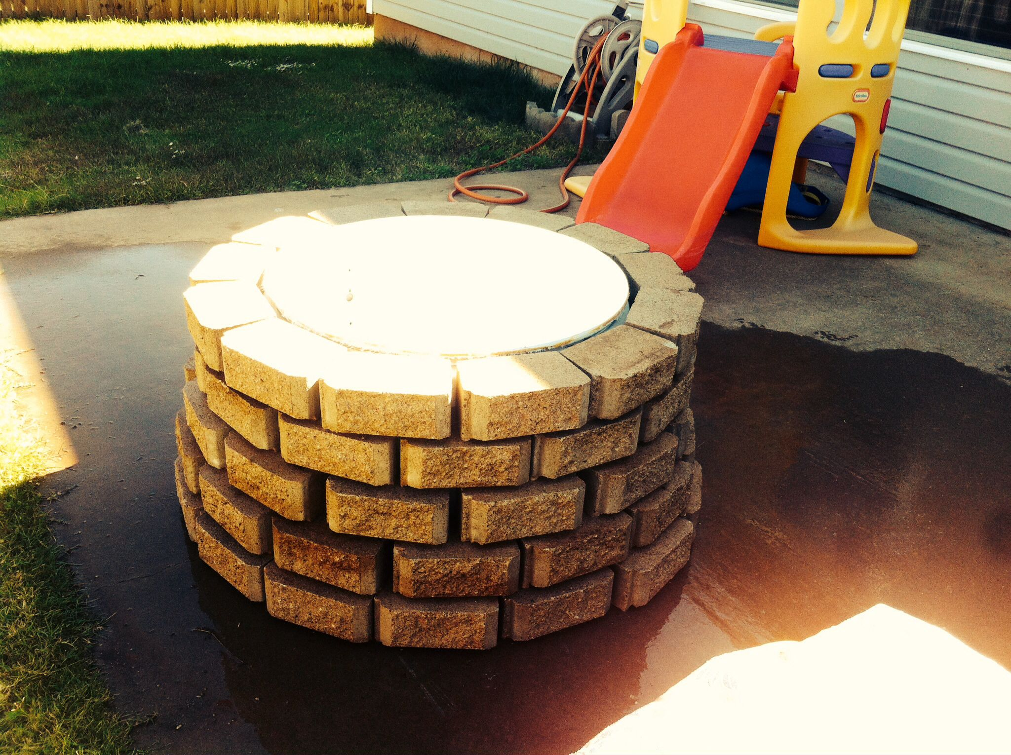 My DIY firepit, just a dryer drum and some landscaping stones, turned out awesome.