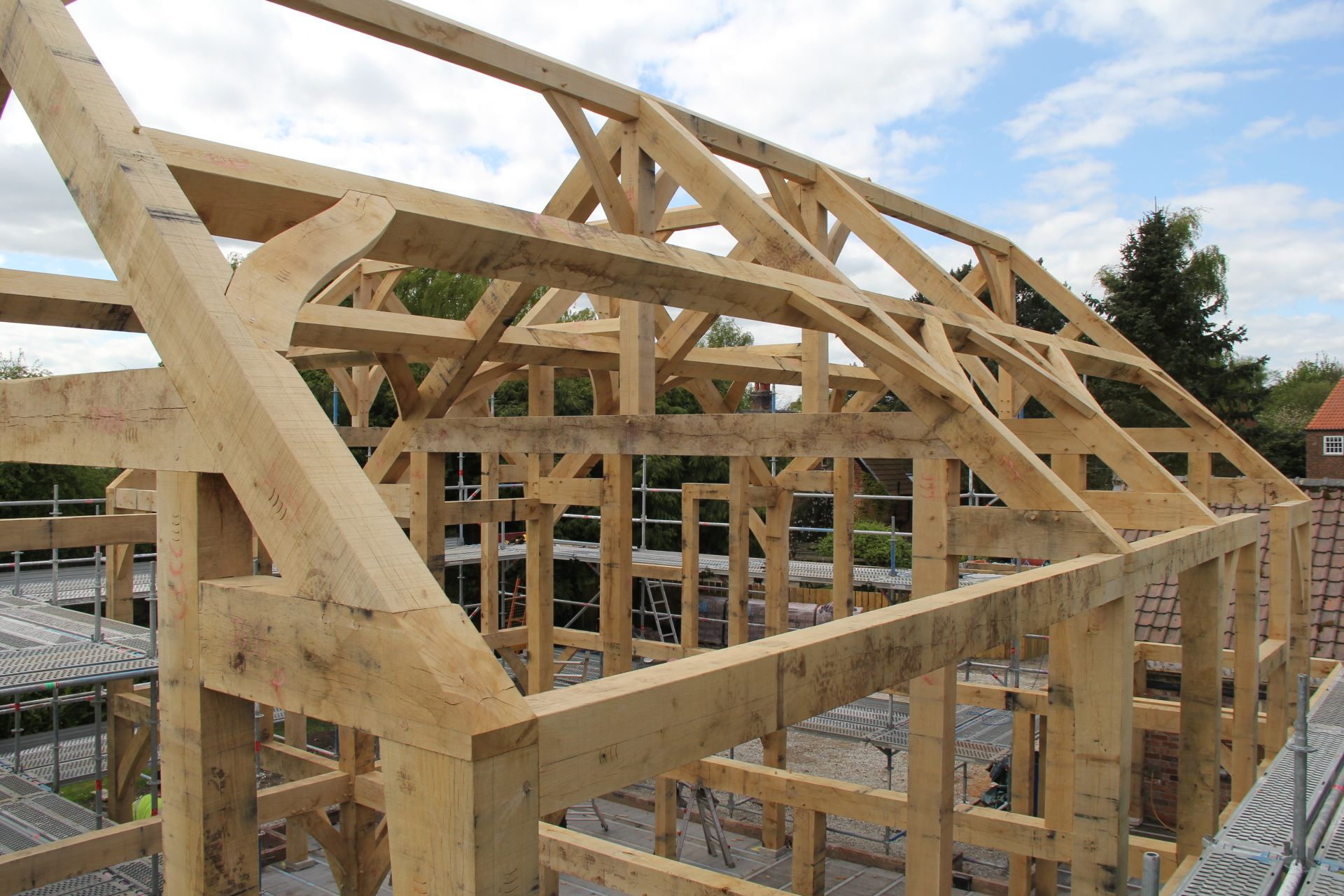 Jowled king post truss with curved struts. Frame raising in Selby ...