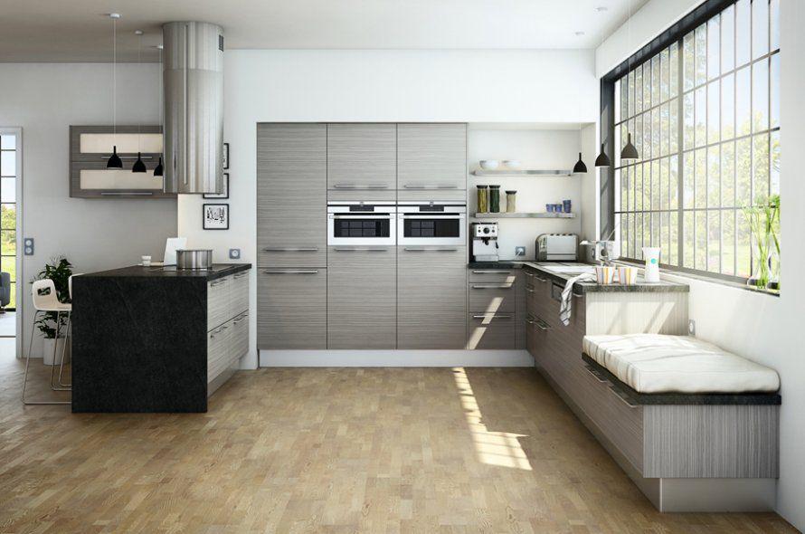 Un îlot de cuisine avec un espace de cuisson - Plan De Cuisine Moderne Avec Ilot Central