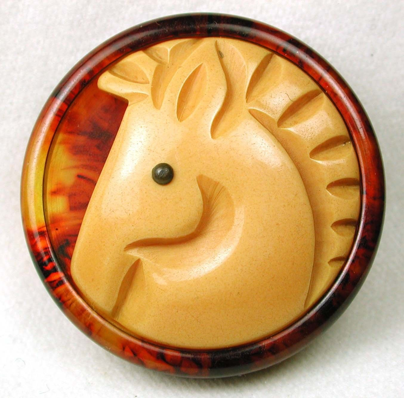 bakelite carved horse button