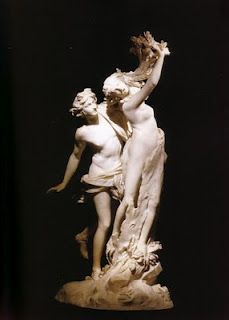 Apollo and Daphne, just as she is turning into a tree!