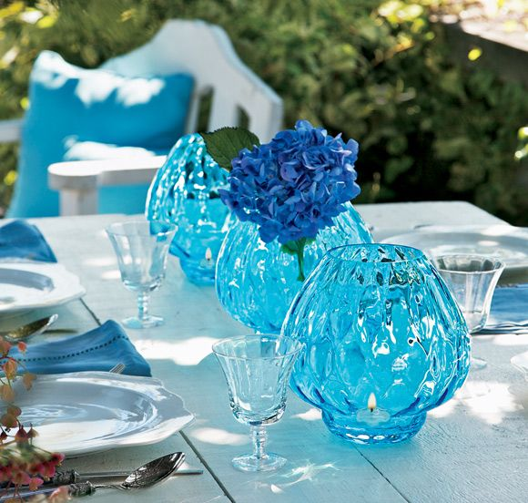 Blue Waves Candle Holder--Crafted of fine European optic glass, this shimmering holder casts beautiful patterns on a wall or table. Each one is hand-blown so the optic pattern varies from piece to piece. Makes an exquisite vase for any floral arrangement, perfect for a summer wedding. http://partylite.biz/sites/adrianbarnett/productcatalog?page=productdetail=P9916=55268=true