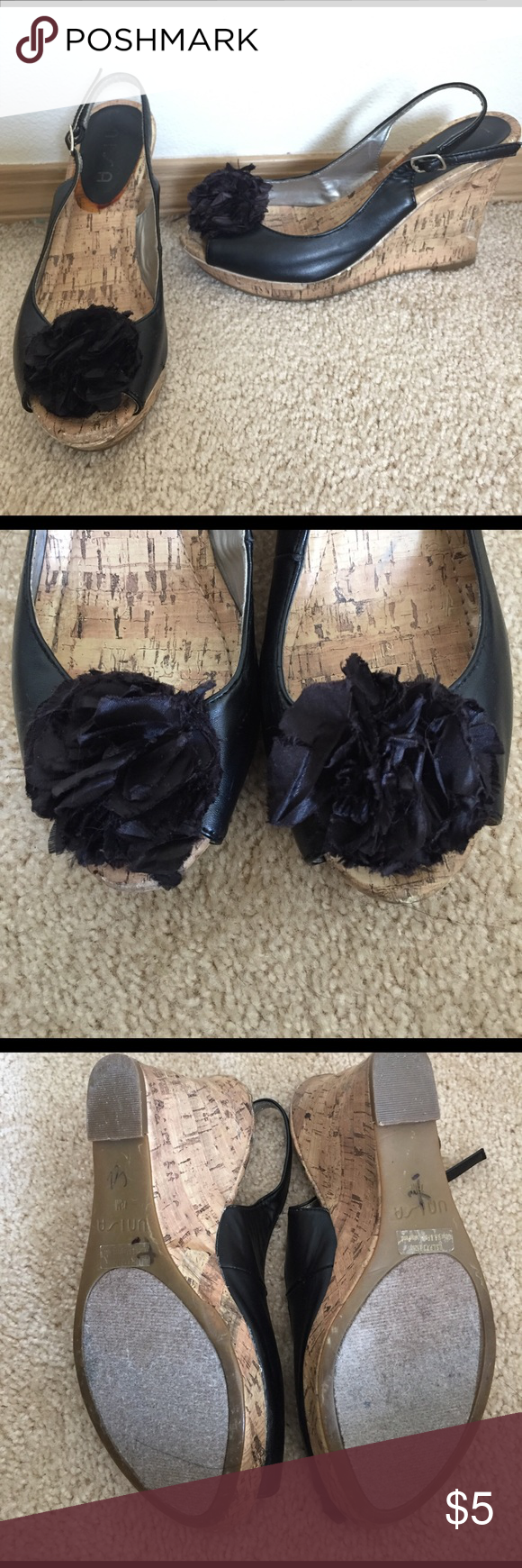 Unisa Wedge peep toe sandals Black leather with cork covered wedges. Black flower with small crystal center on toe. Peep toe. Not perfect but in good condition. Shoes Wedges