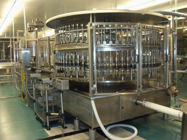 Used US Bottlers Stainless Steel 72 Spout Rotary Filling & Capping Machine