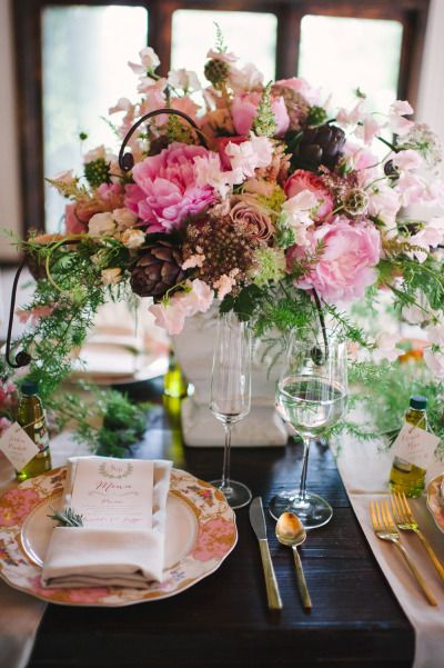 Stunning pink floral arrangement: http://www.stylemepretty.com/south-carolina-weddings/charleston/2014/03/11/tuscan-inspired-shoot-at-magnolia-plantation/ | Photography: Julie Livingston - http://www.julielivingstonphotography.com/