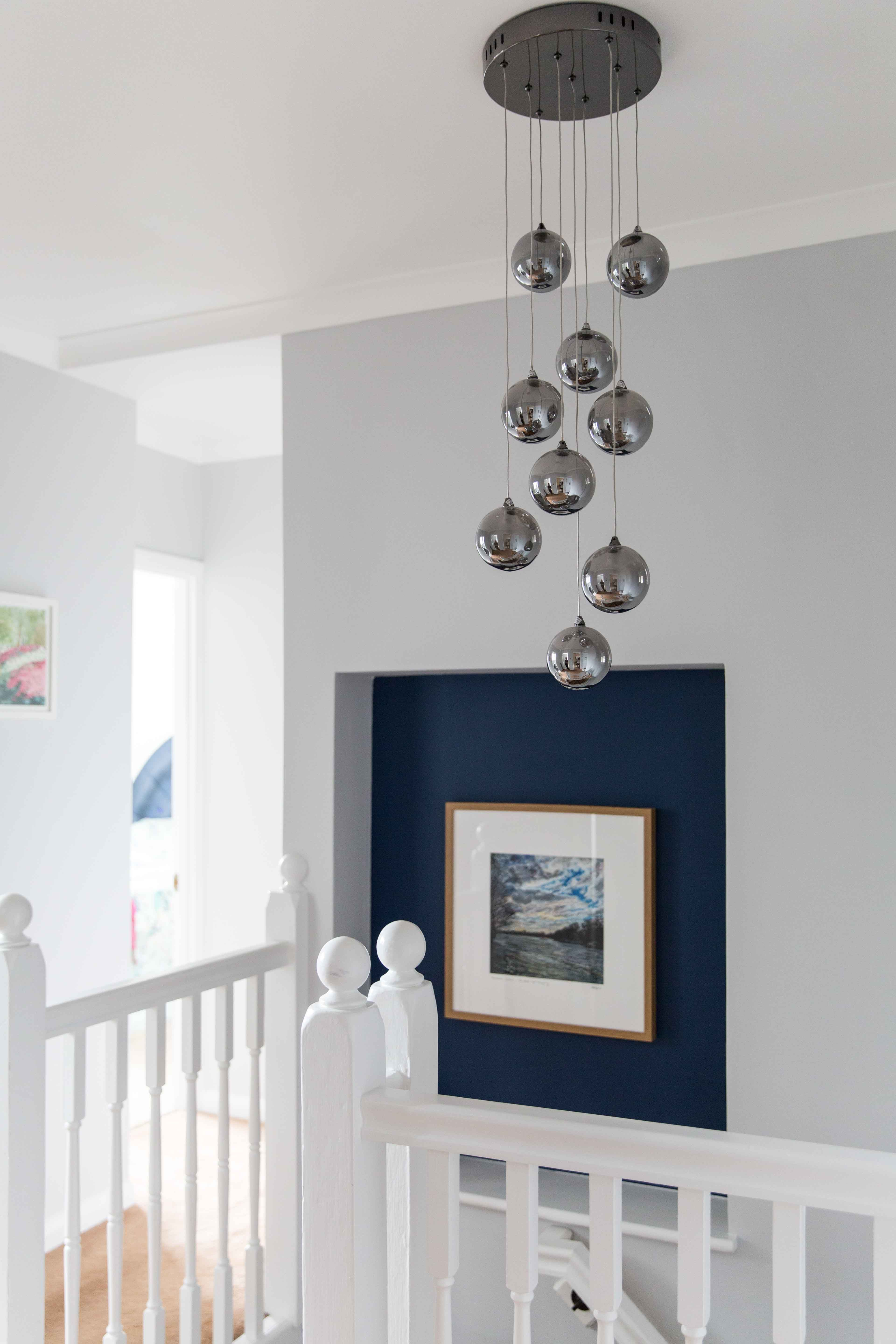 Statement lighting in a narrow hallway creates a focal