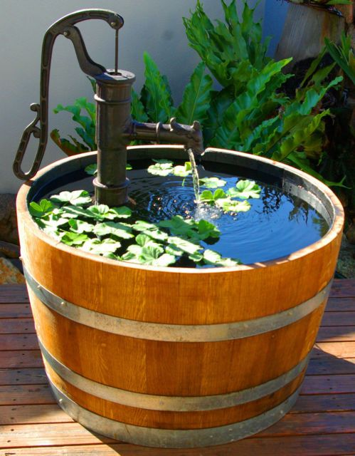 Wine barrel fountain water features ponds pinterest for Planter fish pond