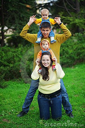 Portrait ideas · family portraits · portrait of happy young parents with their two babies twins having fun in park