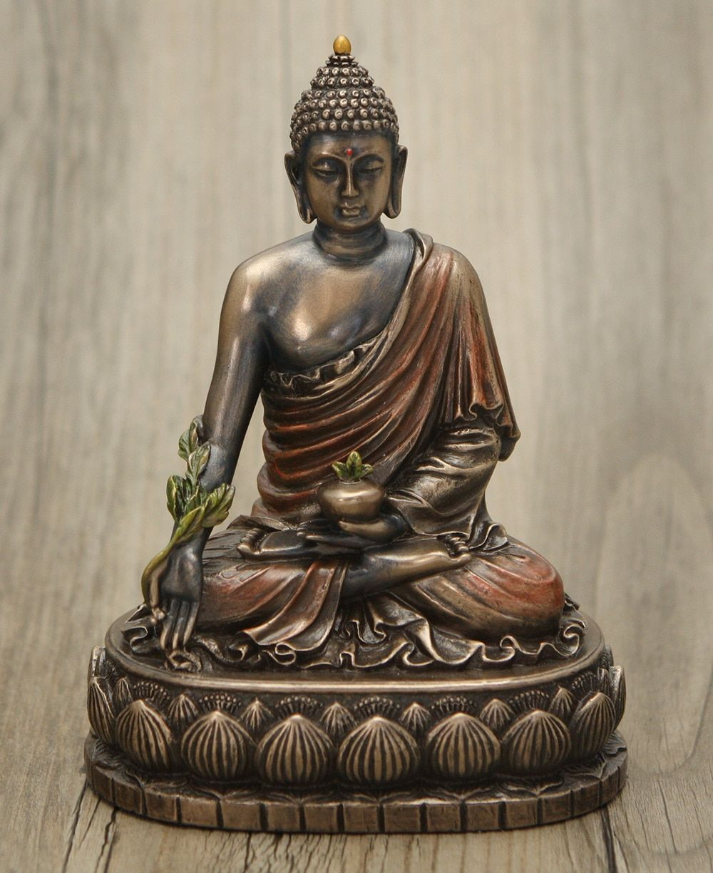 Cold cast bronze medicine buddha statue 6 inches buddha medicine small statue of cold cast bronze depicts the medicine buddha holding symbolic elixir bowl and the biocorpaavc Choice Image