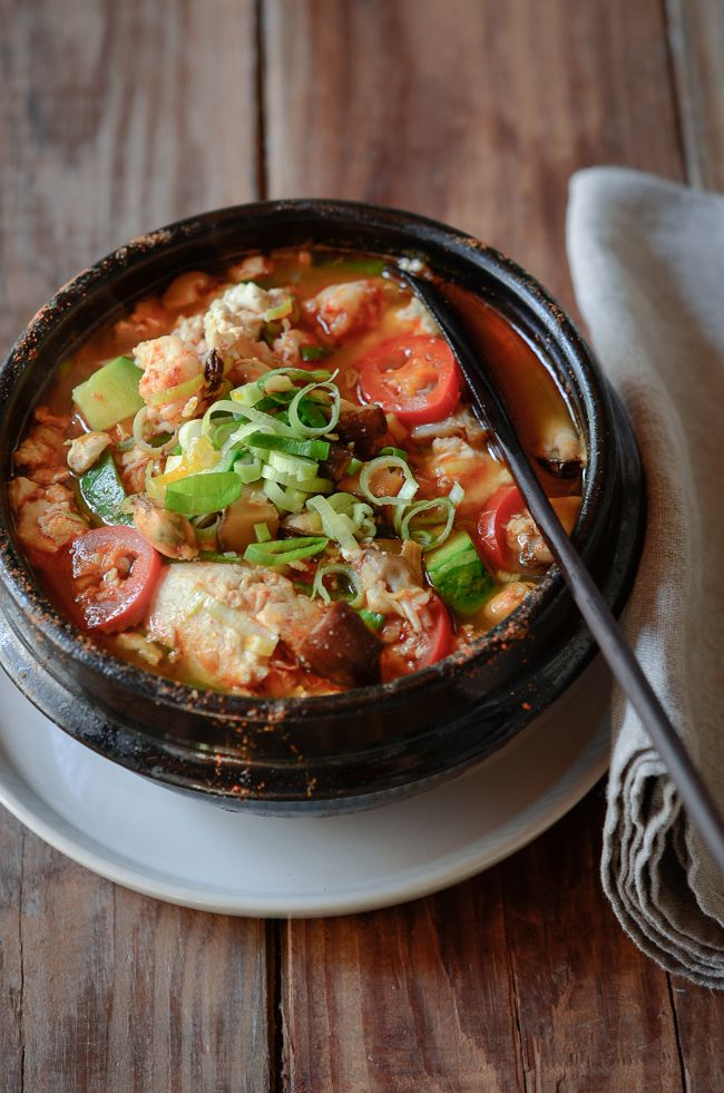 Korean spicy soft tofu stew with beef and seafood ...