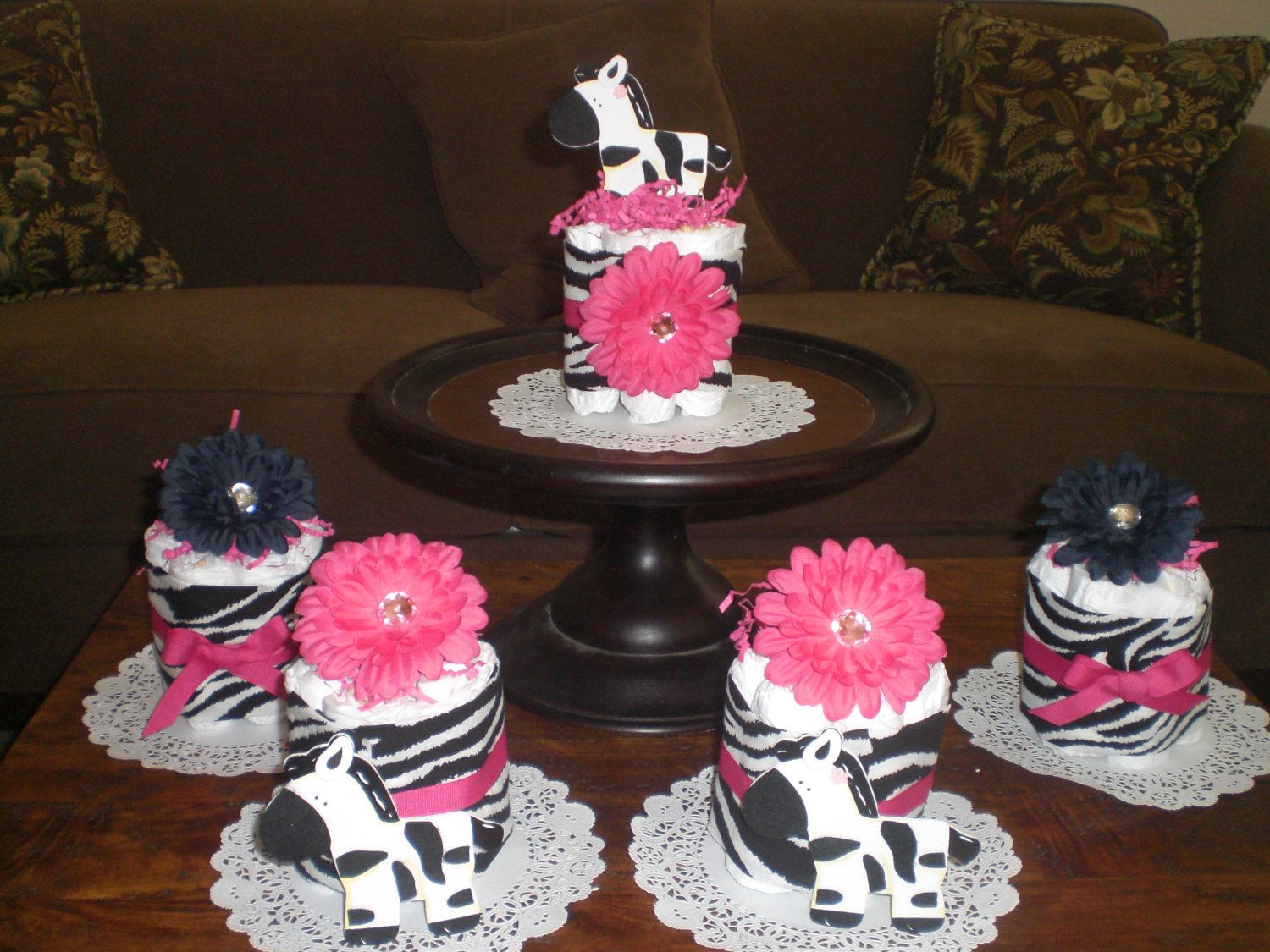 Zebra and hot pink mini and bundt diaper cakes and bootie for Pink diaper bouquet