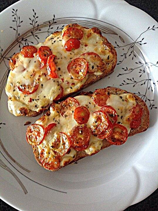 Photo of Baked baguette slices with tomatoes and mozzarella