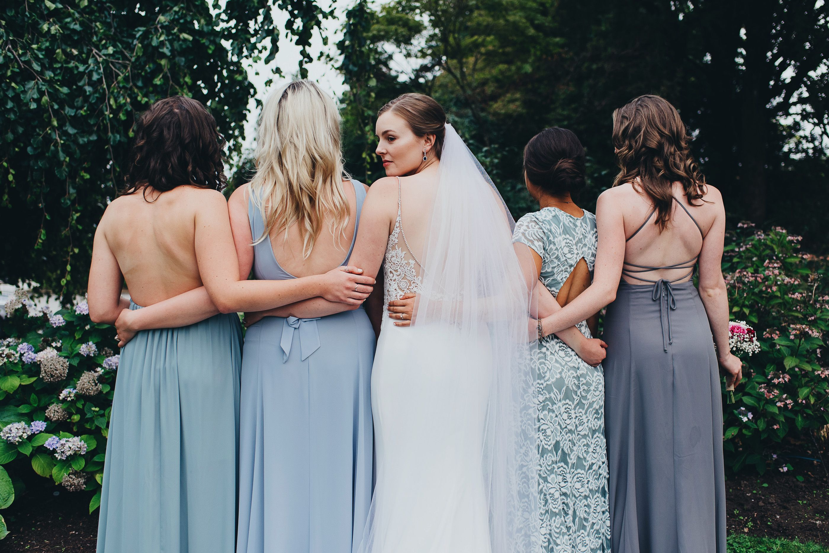 f01521b4aa7a Show Me Your Mumu bridesmaid dresses: Godshaw Goddess Gown in Soft Charcoal  Luna in Silver Sage Eleanor in Silver Sage Lace Jenn in Steel Blue Photo:  ...