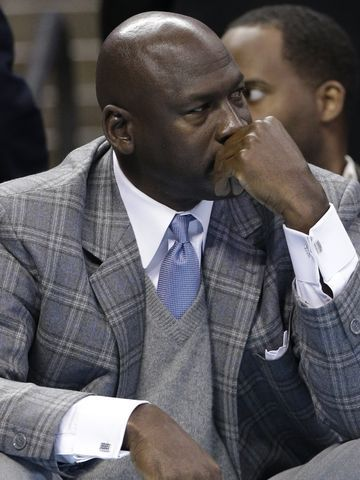 An Atlanta woman has filed a lawsuit saying basketball Hall of Famer and Charlotte Bobcats owner Michael Jordan is the father of her 16-year-old son. (via @Matt Valk Chuah Associated Press)