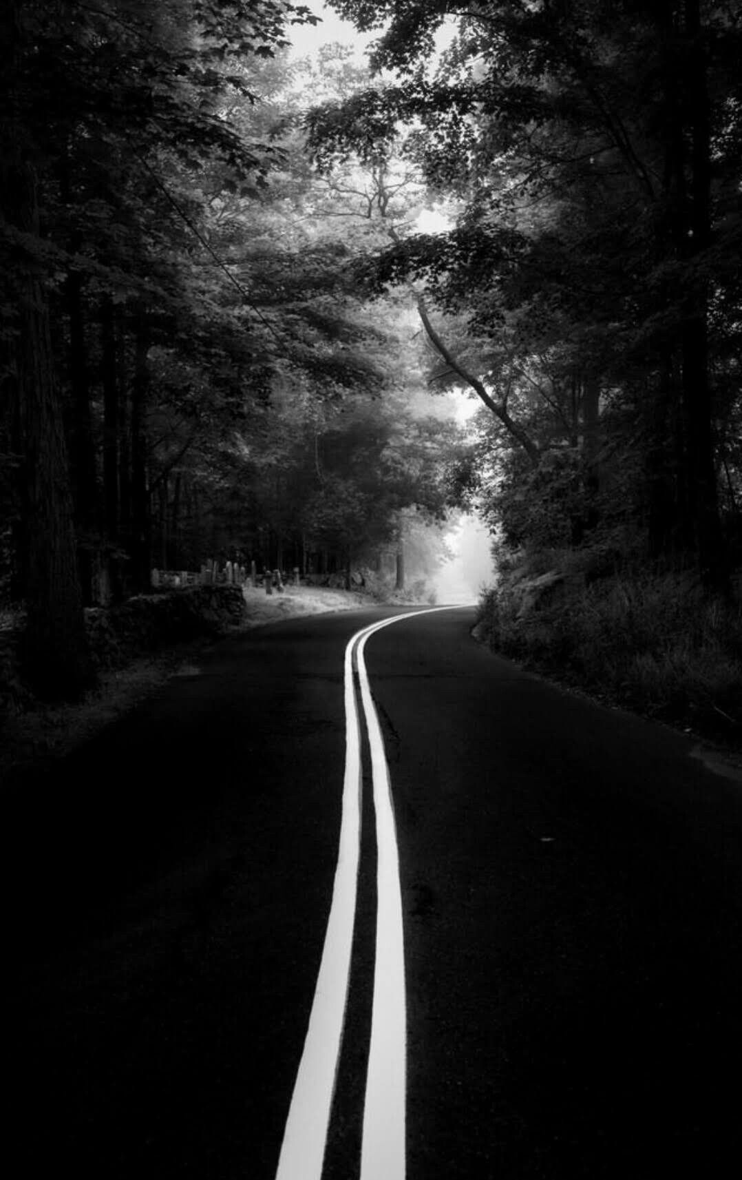 The light at the end of the tunnel road photography black photography monochrome photography
