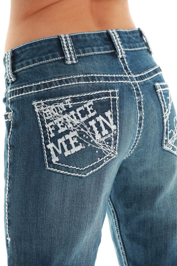 Cowgirl Tuff Jeans  Don't Fence Me In® Limited Edition! Barbed wire gone wild with flirty inline crystals. Thick embroidery on rear pockets with Don't Fence Me In® on one side and barbed wire swirls on the other. Thick corded stitching tracing seams and double lines accenting the belt loops. Front coin pocket is even getting in on the barbed wire action. Definitely Cowgirl Tuff™! Medium wash denim. Cotton/spandex.