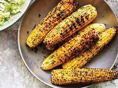 Grilled Corn with Herb Butter - Grilled corn on the barbecue is so easy to do and it takes it to a different level (just try to get local heirloom / non-GMO'd corn!