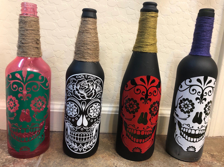 Tiny Glass Bottles Water Bottle Motivation Repurposed Plastic Christmas Bottle Crafts In 2020 Sugar Skull Wine Skull Wine Painted Wine Bottles