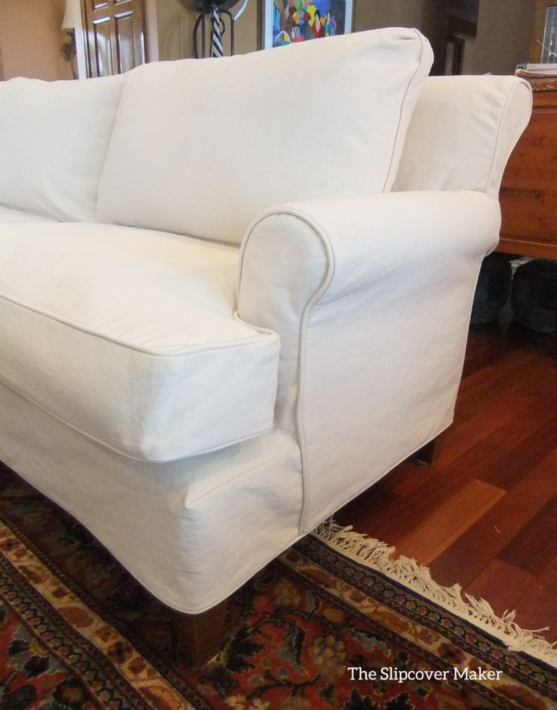 Fitted natural denim slipcover updates this family sofa beautifully. Love the simple, relaxed look. Fabric: 12 oz. Big Duck Canvas.